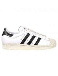 Sneakers bianca con tre strisce nere